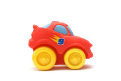Rubber car. Smiling red rubber toy car with yellow wheels isolated on white background side view Stock Images