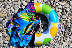Rubber circle. Multicolored rubber circle for swimming and pareo on the beach Royalty Free Stock Photos