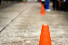 The rubber cone on the road is a sign to be careful.  Stock Photography