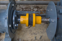 Rubber coupling during motor and pump. In industrial factory stock image