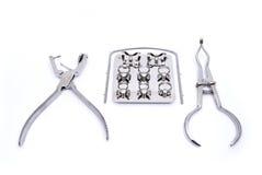 Rubber dam. Dental kit rubber dam frame, punch, forceps Royalty Free Stock Image