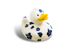 Rubber duck. Cute white rubber duck with blue flower isolated on white Stock Photo