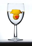 Rubber duck. Colorful rubber duck, upside down in wine glass royalty free stock photos