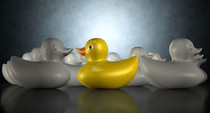 Rubber Duck Against The Flow. A yellow rubber bath duck swimming against the flow of a group of grey rubber ducks on a dark backlit background stock illustration