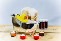Rubber duck in bath, symbolic, voucher, wellness, wellness vouch. Er, candles royalty free stock photo