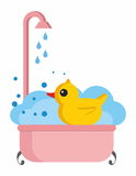 Rubber duck in bath Stock Photos