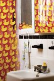 Rubber duck bathroom. Bathroom of old appartment decorated with a rubber duck theme Stock Image