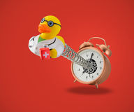 Rubber duck doctor coming out of alarm clock Stock Photography