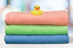Rubber Duck On Towels Stock Photo