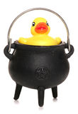 Rubber duck in witches cauldren Royalty Free Stock Image