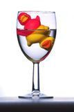 Rubber ducks. Two colorful rubber ducks in wine glass royalty free stock photo