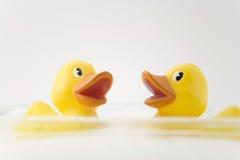 Rubber Ducks. In bubble bath Stock Photo