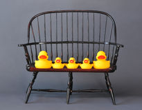 Rubber ducks on chair Royalty Free Stock Photography