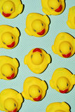 Rubber ducks on a dot-patterned background Royalty Free Stock Image