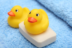 Rubber Ducks on the soft towel and soap Royalty Free Stock Images