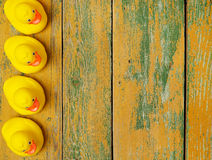 Rubber ducks on wood Royalty Free Stock Photos