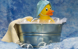 Rubber Ducky. In tub enjoying a bubble bath royalty free stock photography