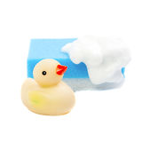 A rubber ducky and cyan  bath sponge Royalty Free Stock Images