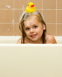 Rubber ducky on her head Stock Photography