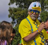 Rubber Ducky Master of Ceremony with Microphone at Rubber Duck Festival. Senior volunteer announcing the start of another race at the 16th Rubber Ducky Festival stock images