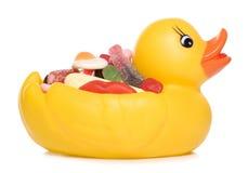 Rubber eend met snoepjes Stock Foto
