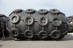 Rubber fenders for ships. Blacks Royalty Free Stock Photography