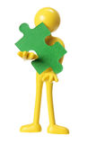 Rubber Figure with Piece of Jigsaw Puzzle Royalty Free Stock Image