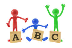 Rubber Figures with Alphabet Blocks Royalty Free Stock Photo
