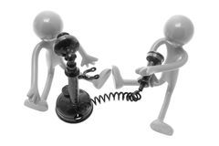 Rubber Figures with Antique Phones royalty free stock photos