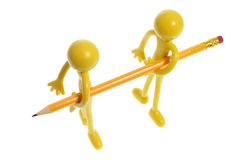 Rubber Figures Carrying Pencil royalty free stock images