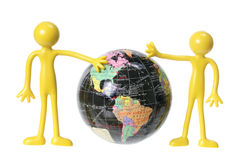 Rubber Figures with Globe Royalty Free Stock Image
