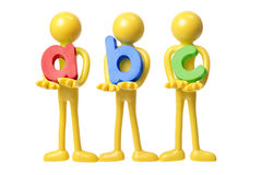 Rubber Figures Holding ABC Royalty Free Stock Photo