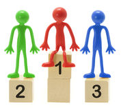 Rubber Figures on Podium Stock Image