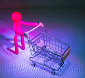 Rubber Figures with a shopping cart Stock Photo