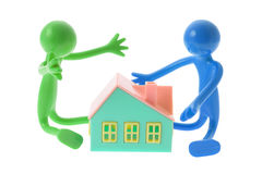 Rubber Figures with Toy House Stock Photo