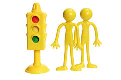 Rubber Figures and Traffic Light Royalty Free Stock Photography