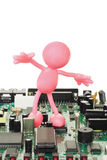 Rubber figurine on circuit board Stock Photography