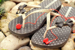 Rubber flip-flops with earphone Royalty Free Stock Photography