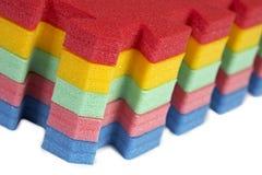 Rubber foam puzzle Stock Images