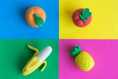 Rubber fruits on colorful background minimal creative concept. stock images