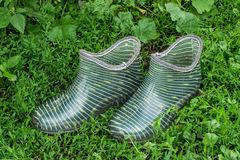Rubber galoshes in the grass Royalty Free Stock Images