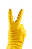 Rubber glove. Yellow rubber glove with victory sign Royalty Free Stock Photos