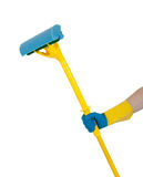 A rubber glove holding a mop on white Royalty Free Stock Photo