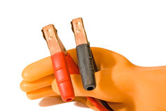 Rubber glove holds plugs Stock Photos