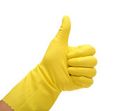 Rubber glove thumbs up. Photograph of a human had wearing a yellow washing up glove giving the thumbs up sign Royalty Free Stock Images