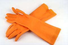 Rubber Gloves. Rubber cleaning gloves on a white background Stock Photos
