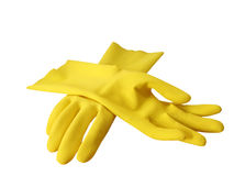 Rubber gloves. Pair of yellow rubber cleaning gloves for housework isolated a white background with clipping path stock image