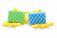 Rubber gloves and a cleaning sponges. Stock Image