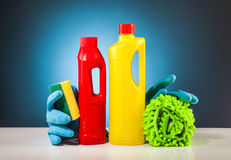 Rubber gloves colorful cleaning equipment and blue background Stock Photos