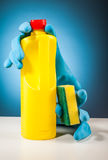 Rubber gloves colorful cleaning equipment and blue background Stock Photo